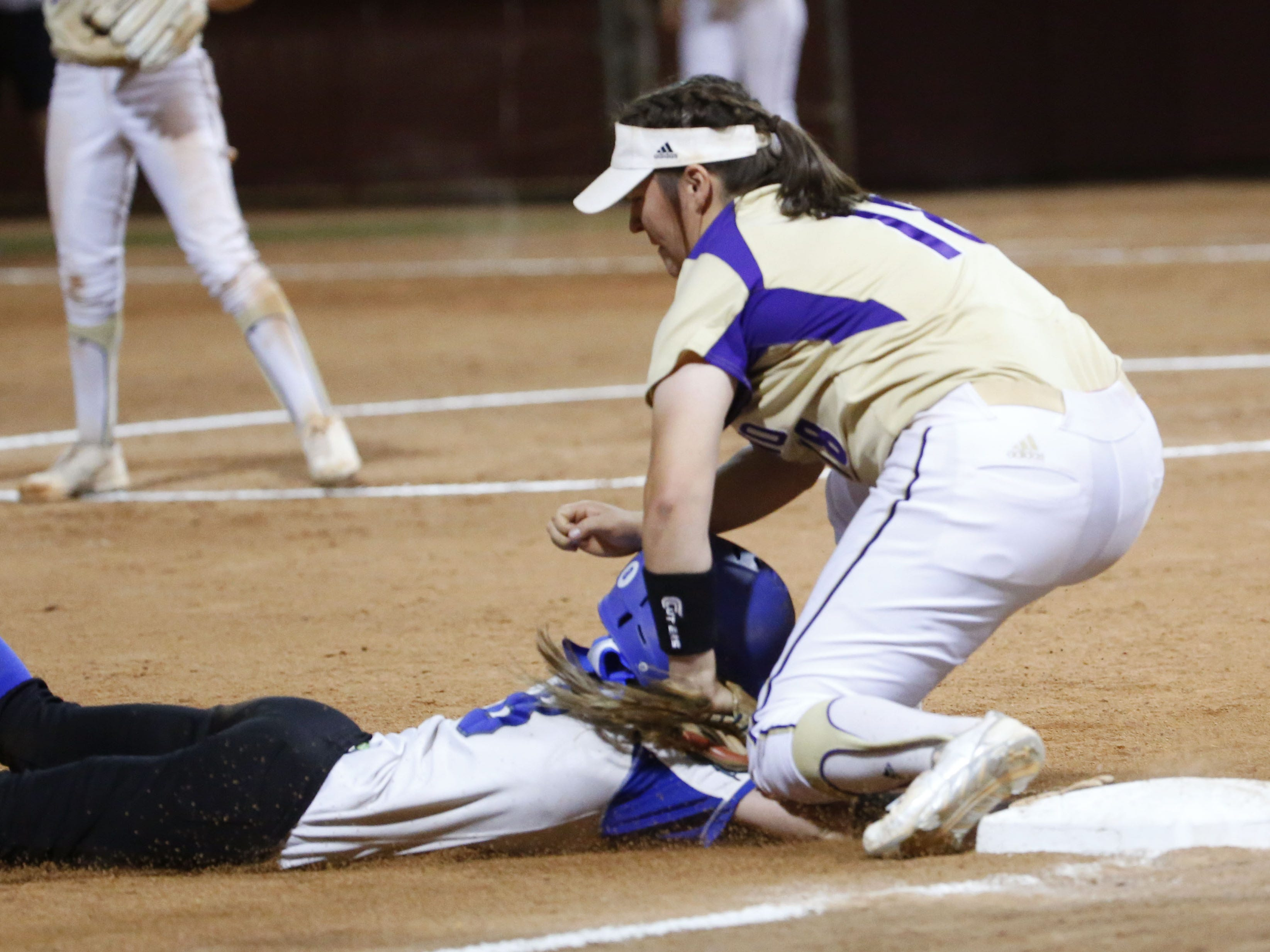 Snowflake center fielder Kaylee Thomas (8) slides in into third ahead of the tag by Sabino's Riley Carley (18) during the 3A softball state championship game in Tempe May 6, 2019.