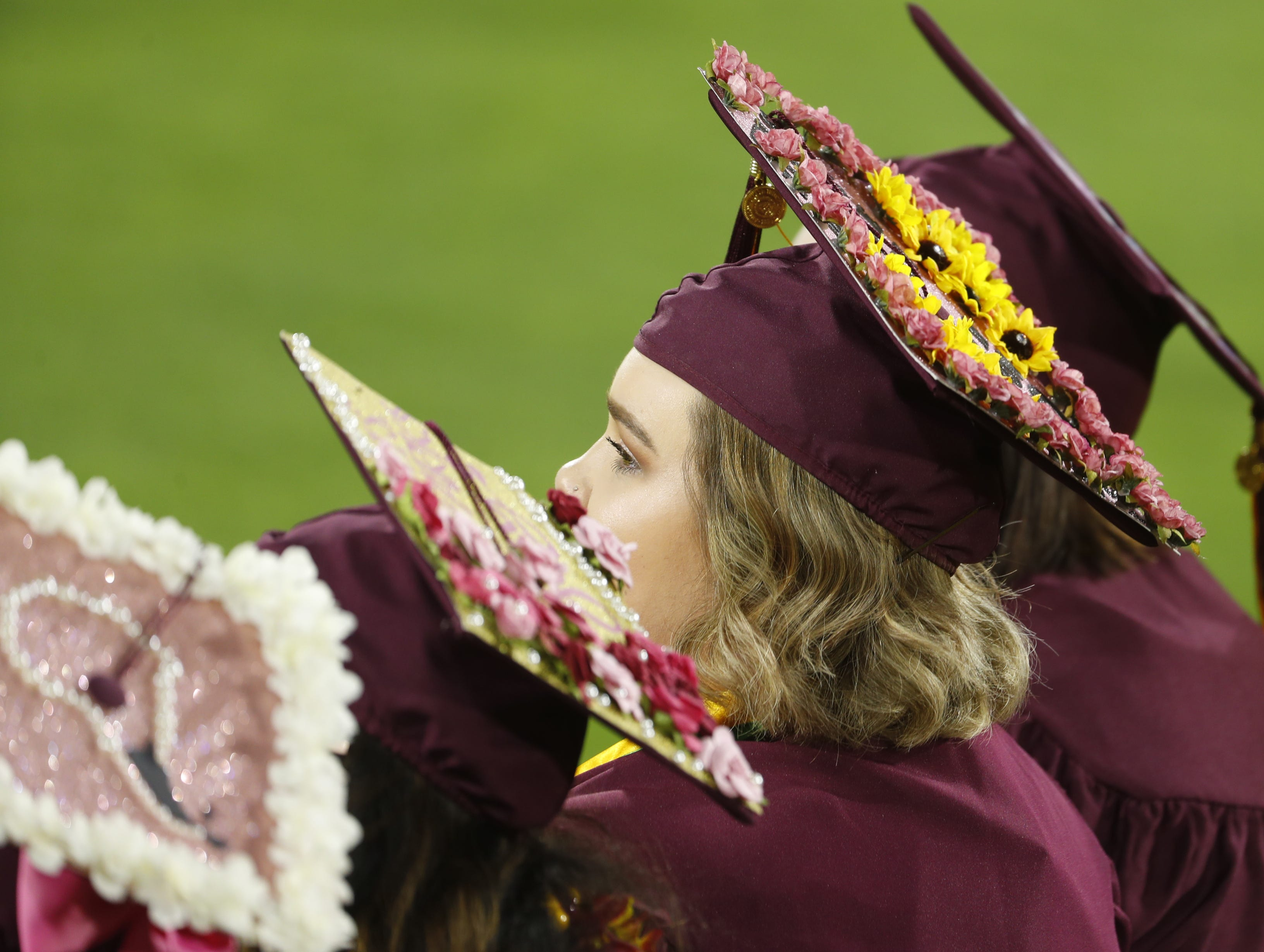ASU students watch President Michael Crow speak during ASU's Undergraduate Commencement at Sun Devil Stadium in Tempe, Ariz. on May 6, 2019.
