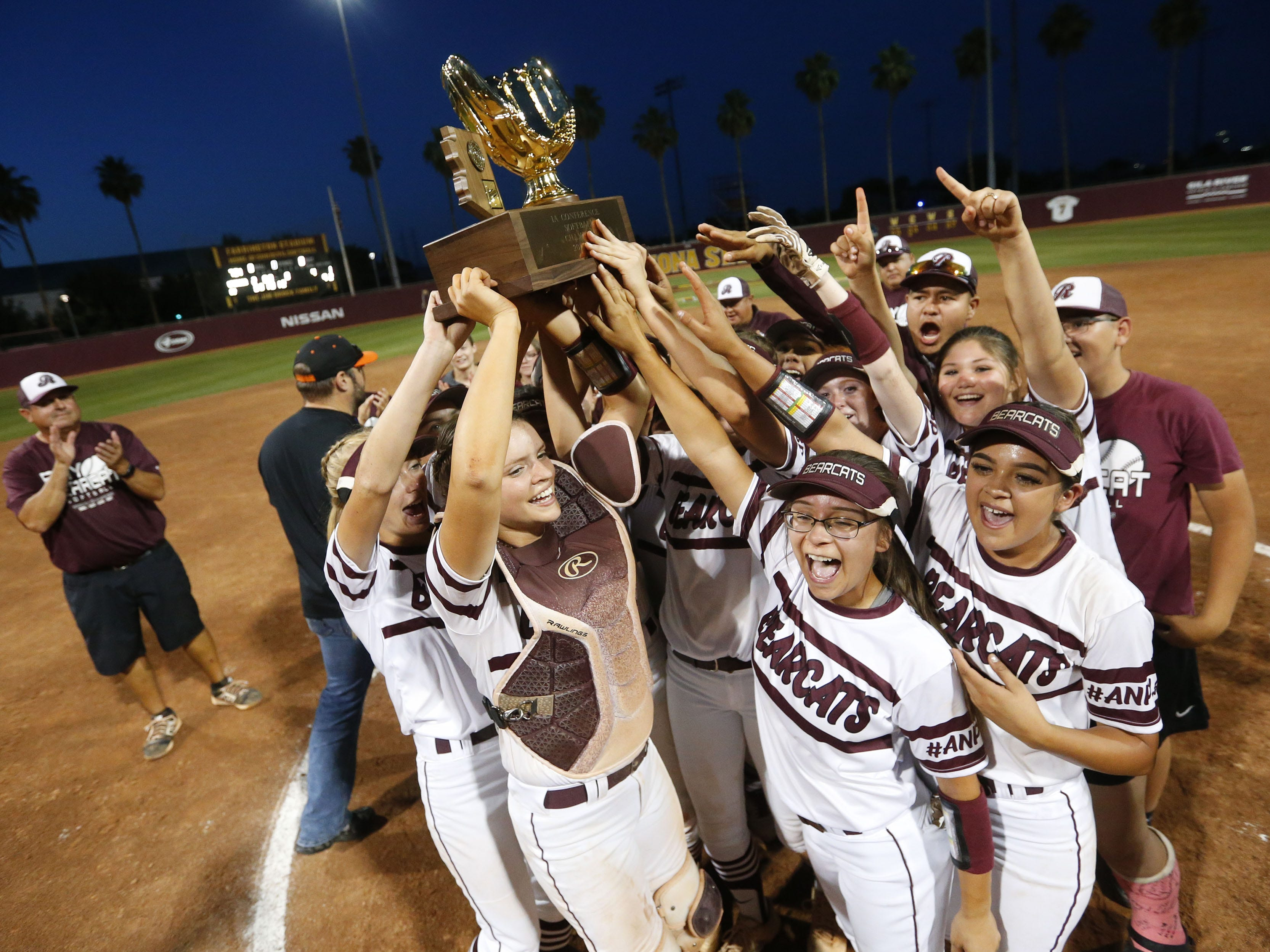 Ray players celebrate after beating Superior in the 1A softball state championship game in Tempe May 6, 2019.