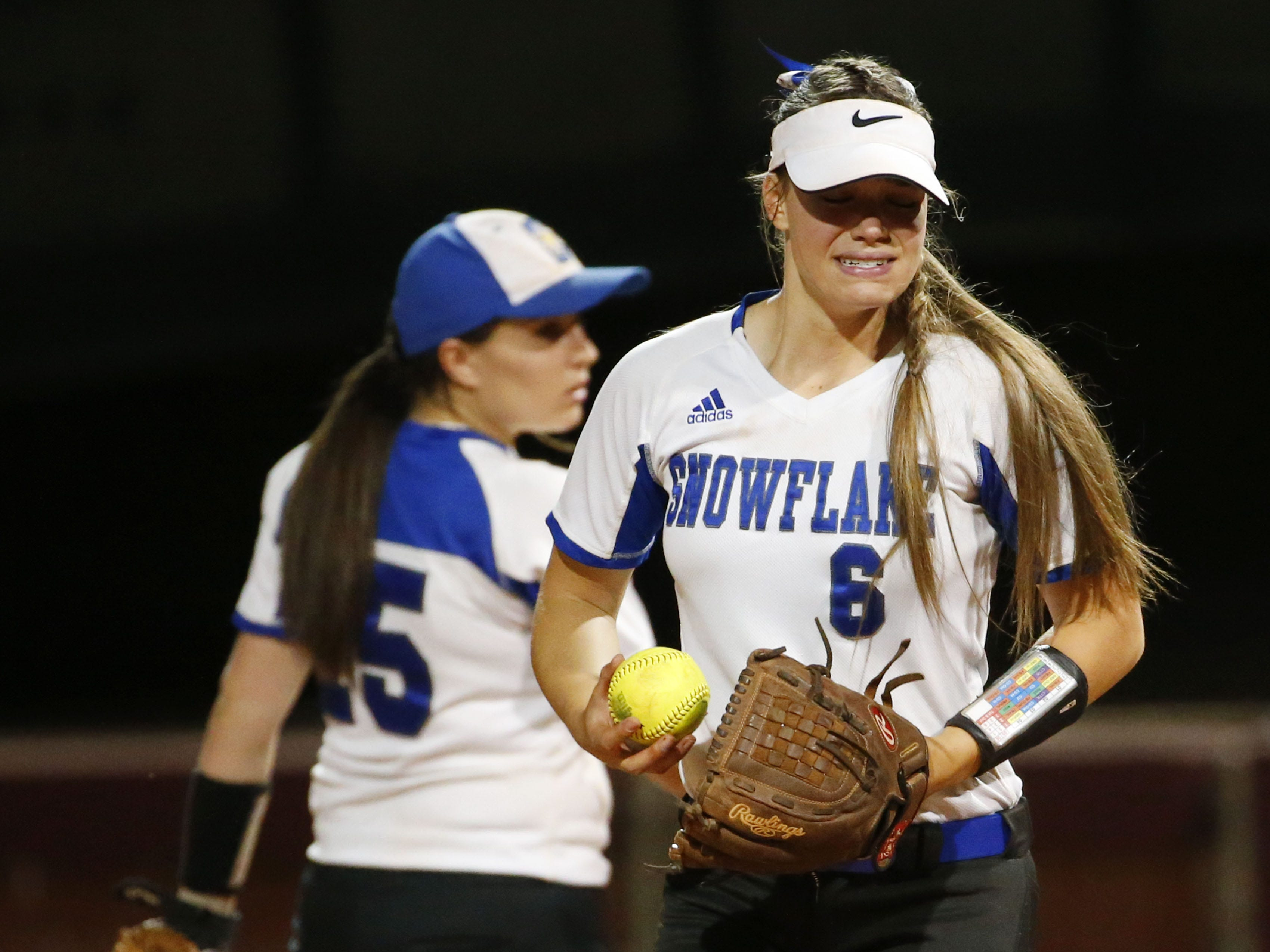 Snowflake pitcher Anna Berger (6) grimaces after being hit by the ball against Sabino during the 3A softball state championship game in Tempe May 6, 2019.