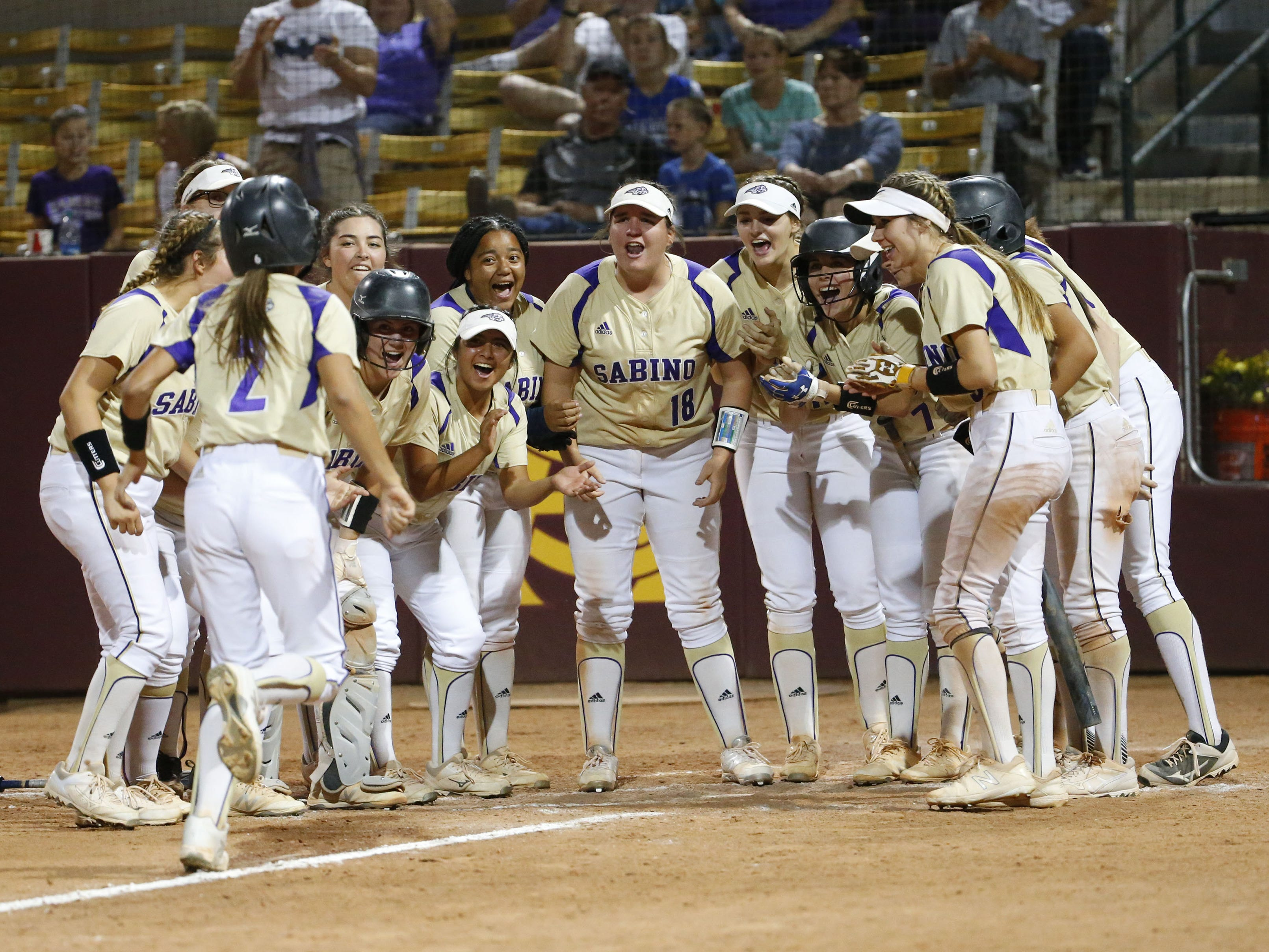 Sabino's Hannah Stark (2) is congratulated by teammates after hitting a solo home run against Snowflake in the 3A softball state championship game in Tempe May 6, 2019.
