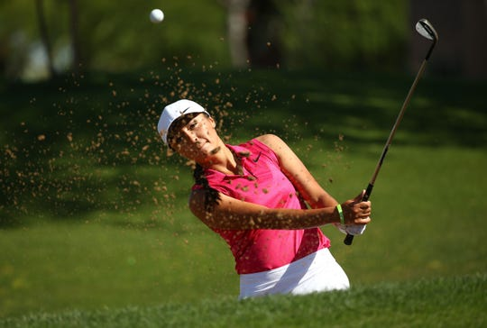 Gabby Lemieux blasts out of a practice bunker on May. 4, 2019 at McDowell Mountain Golf Club in Scottsdale, Ariz. Gabby Lemieux is the only Native American professional golfer in the country.