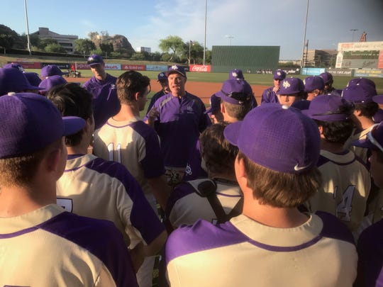 Notre Dame coach Brian Fischer talks to his players after Monday's win at Tempe Diablo Stadium.