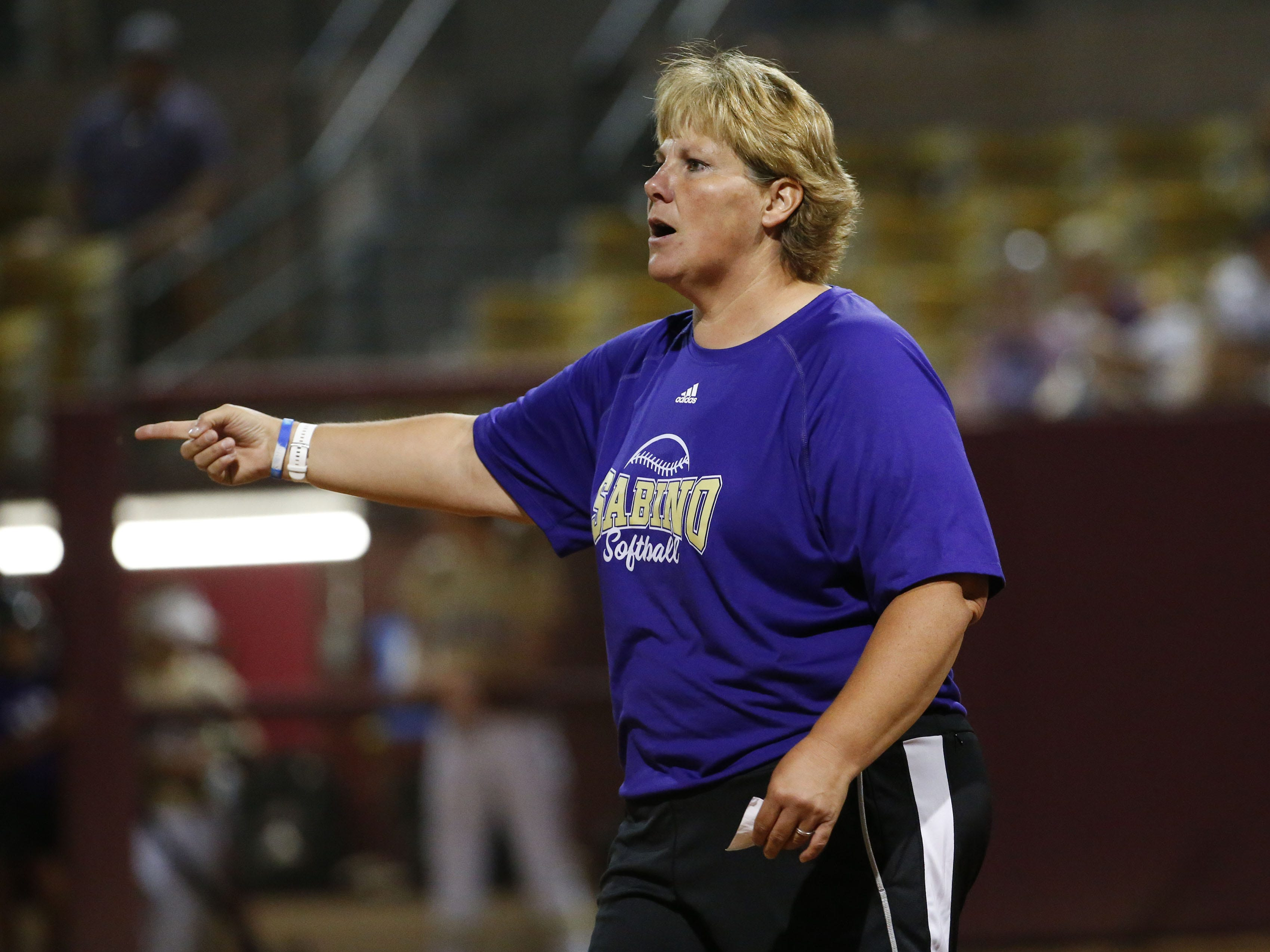 Sabino head coach Chris Stainer directs her team against Snowflake during the 3A softball state championship game in Tempe May 6, 2019.