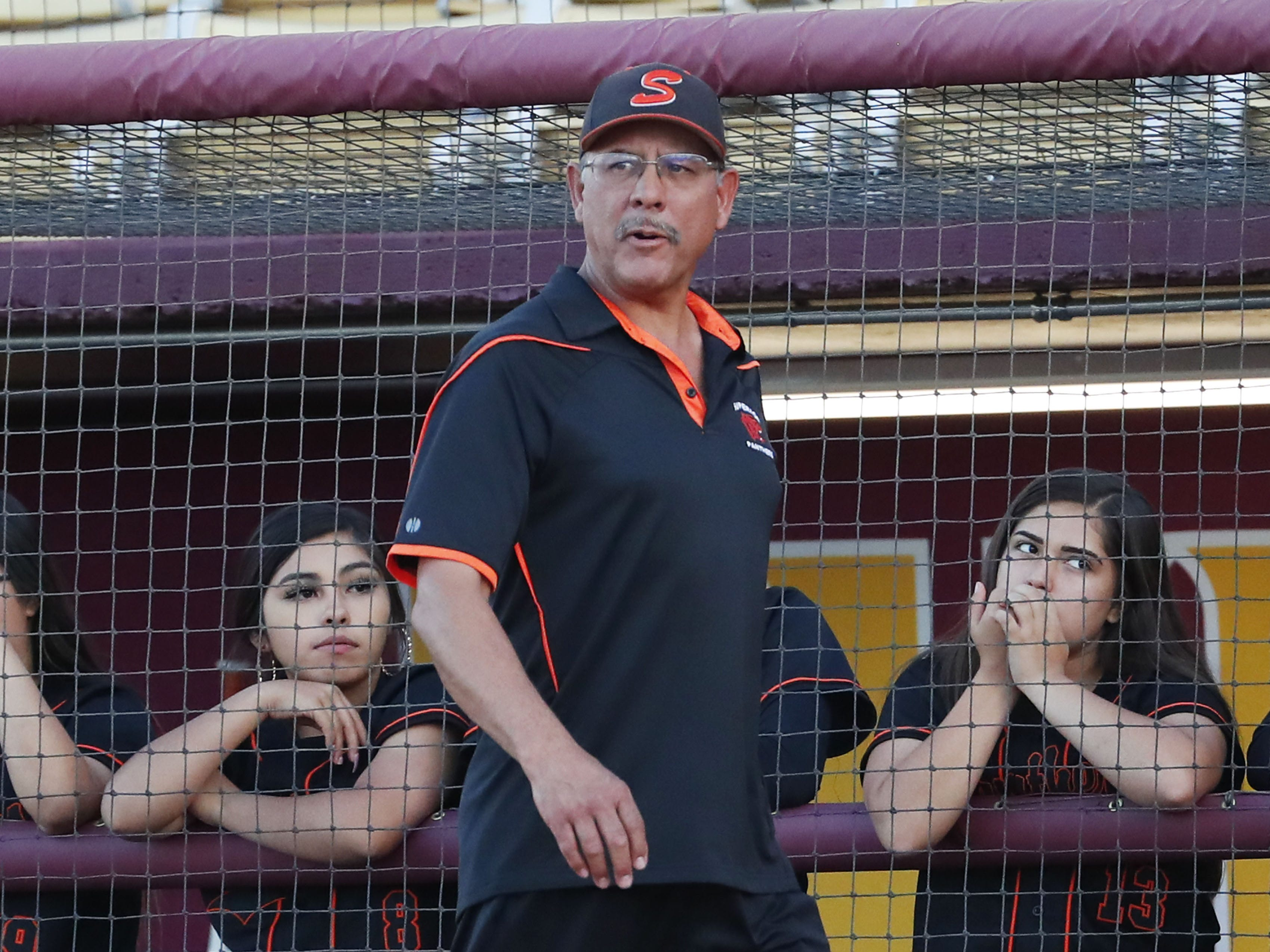 Superior head coach Al Lopez walks towards home plate during the 1A softball state championship game against Ray in Tempe May 6, 2019.