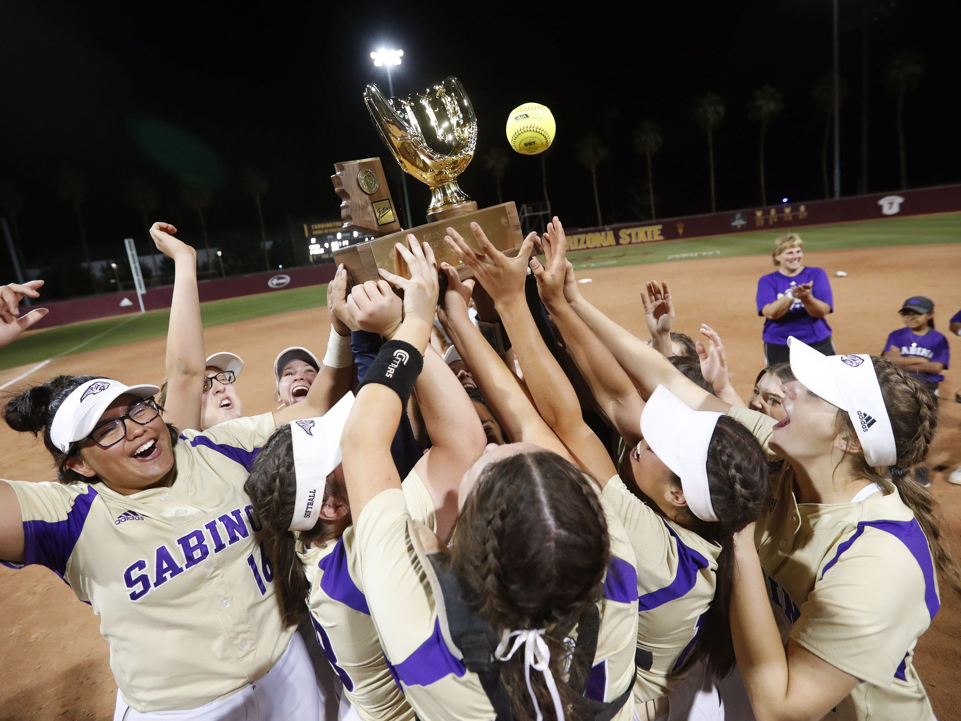Sabino players celebrate after beating Snowflake in the 3A softball state championship game in Tempe May 6, 2019.