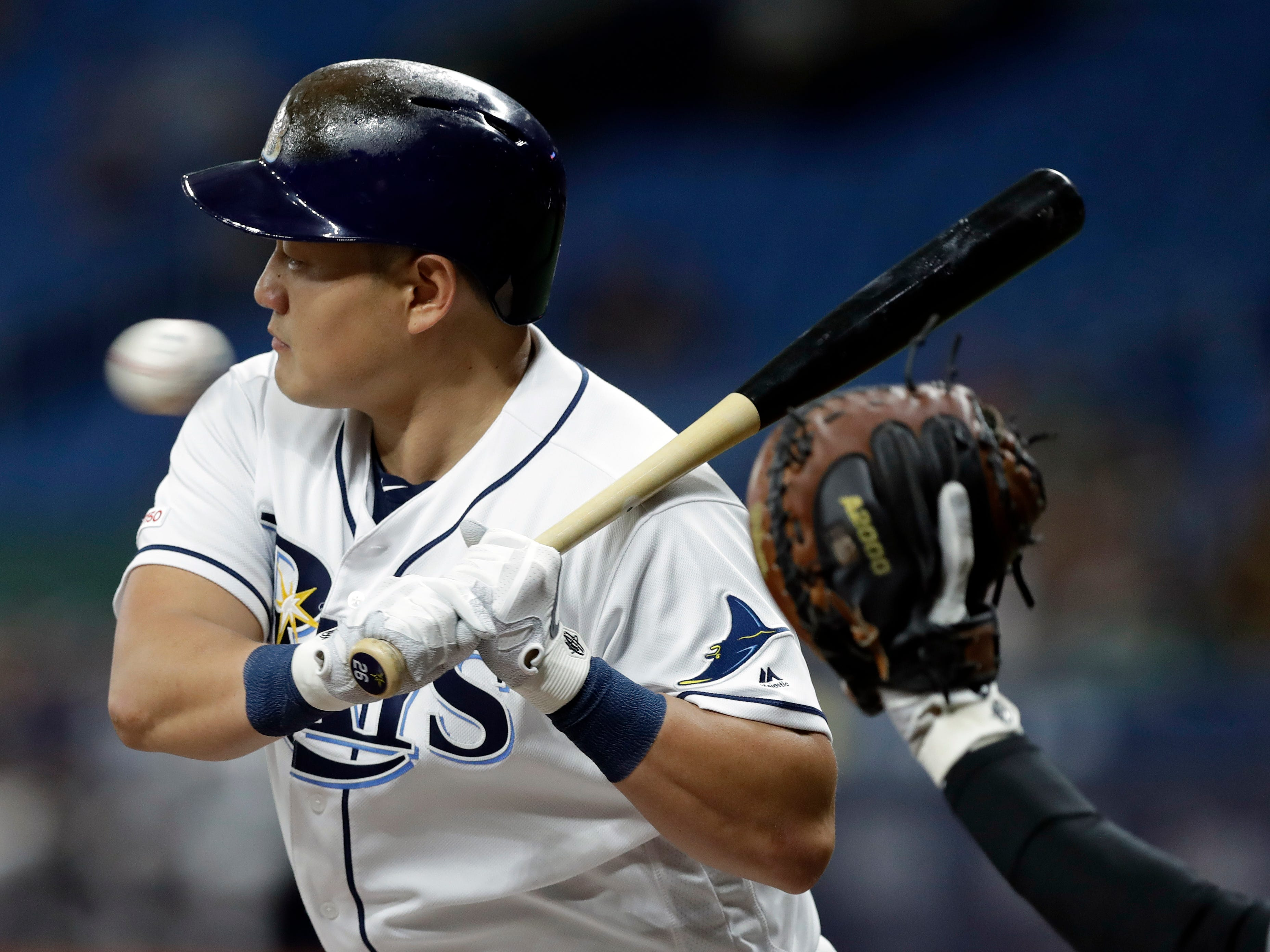 Tampa Bay Rays' Ji-Man Choi, of South Korea, takes an inside pitch from Arizona Diamondbacks starting pitcher Merrill Kelly during the first inning of a baseball game Monday, May 6, 2019, in St. Petersburg, Fla. (AP Photo/Chris O'Meara)