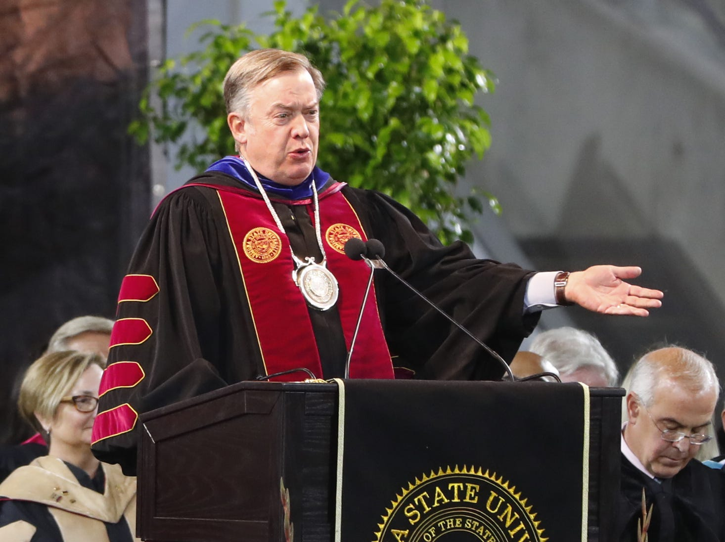 ASU President Michael Crow speaks during ASU's Undergraduate Commencement at Sun Devil Stadium in Tempe, Ariz. on May 6, 2019.
