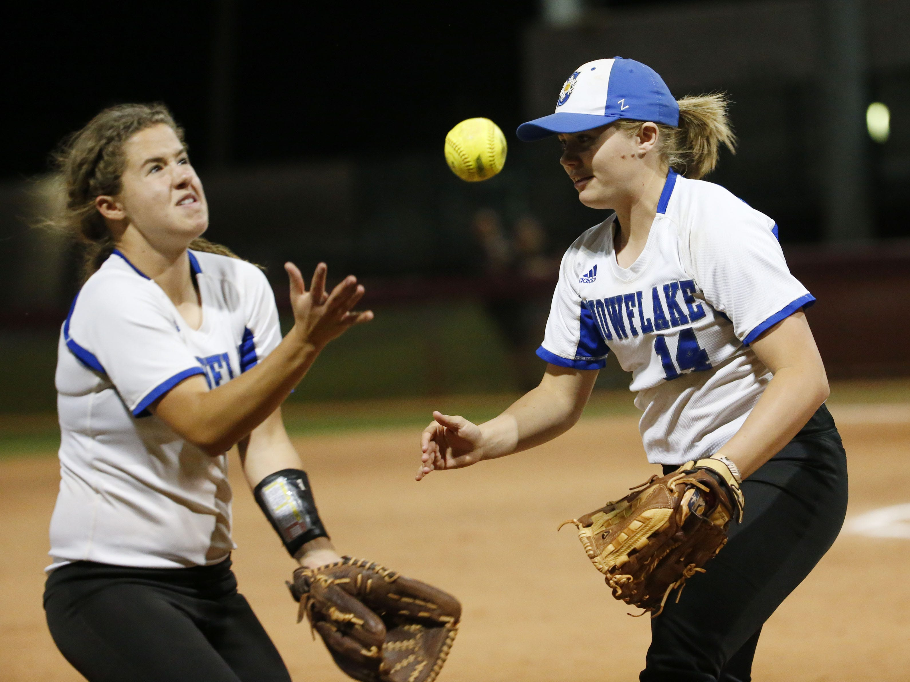 A pop foul by Sabino falls between Snowflake's Taryn Flake (3) and Hallie McCray (14) during the 3A softball state championship game in Tempe May 6, 2019.