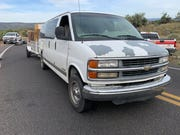The white van at the scene of the collision, after striking a riderless motorcycle, which was flung into traffic after striking the guardrail Sunday afternoon.