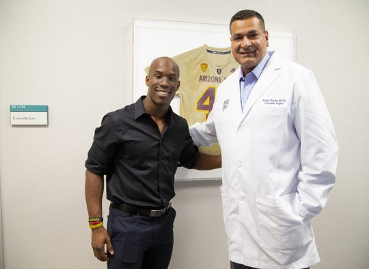 ASU football wide receiver Kyle Williams, left,  was introduced to Dr. Anikar Chhabra, director of sports medicine at Mayo Clinic and ASU team physician, after an injury. Williams prepares for his own career in medicine assisting Chhabra in his research.