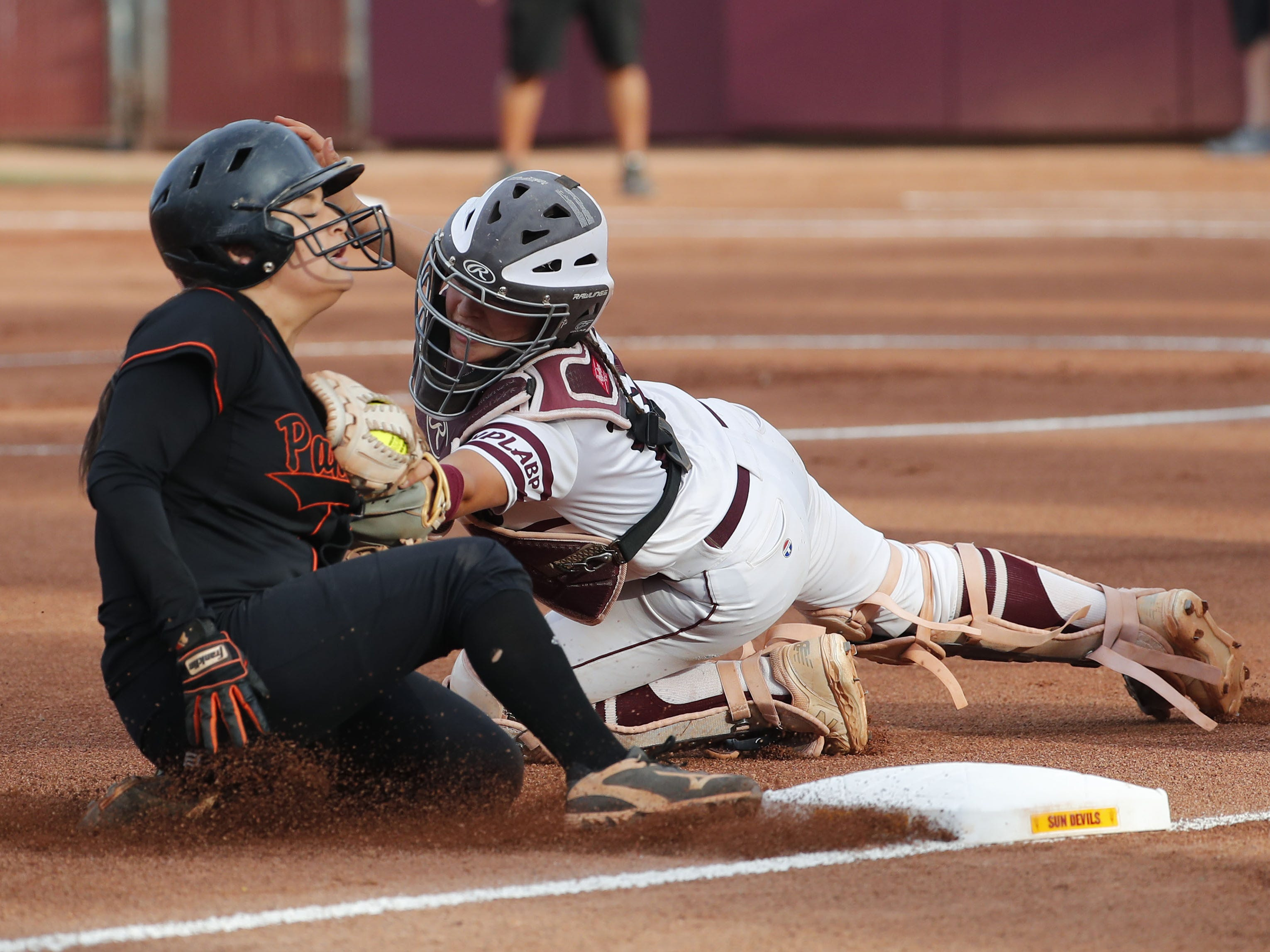 Superior shortstop Anisah Cardenas (3) slides in safely at third base ahead of the tag by Ray catcher Tara Loroña (13) during the 1A softball state championship game in Tempe May 6, 2019.