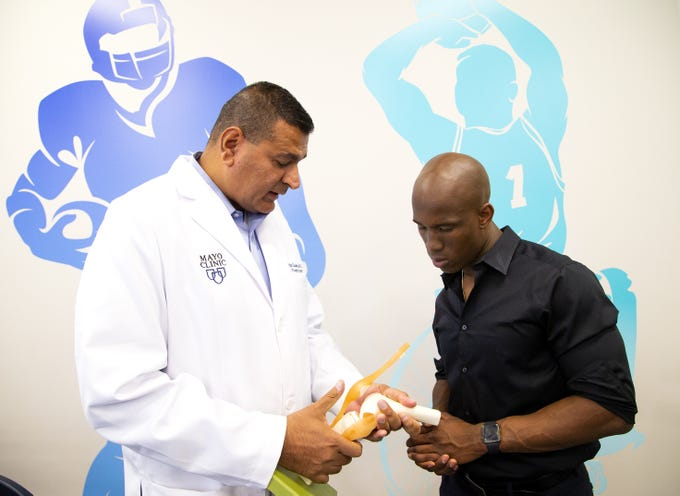 ASU football wide receiver Kyle Williams, right,  was introduced to Dr. Anikar Chhabra, director of sports medicine at Mayo Clinic and ASU team physician, after an injury. Williams prepares for his own career in medicine assisting Chhabra in his research.