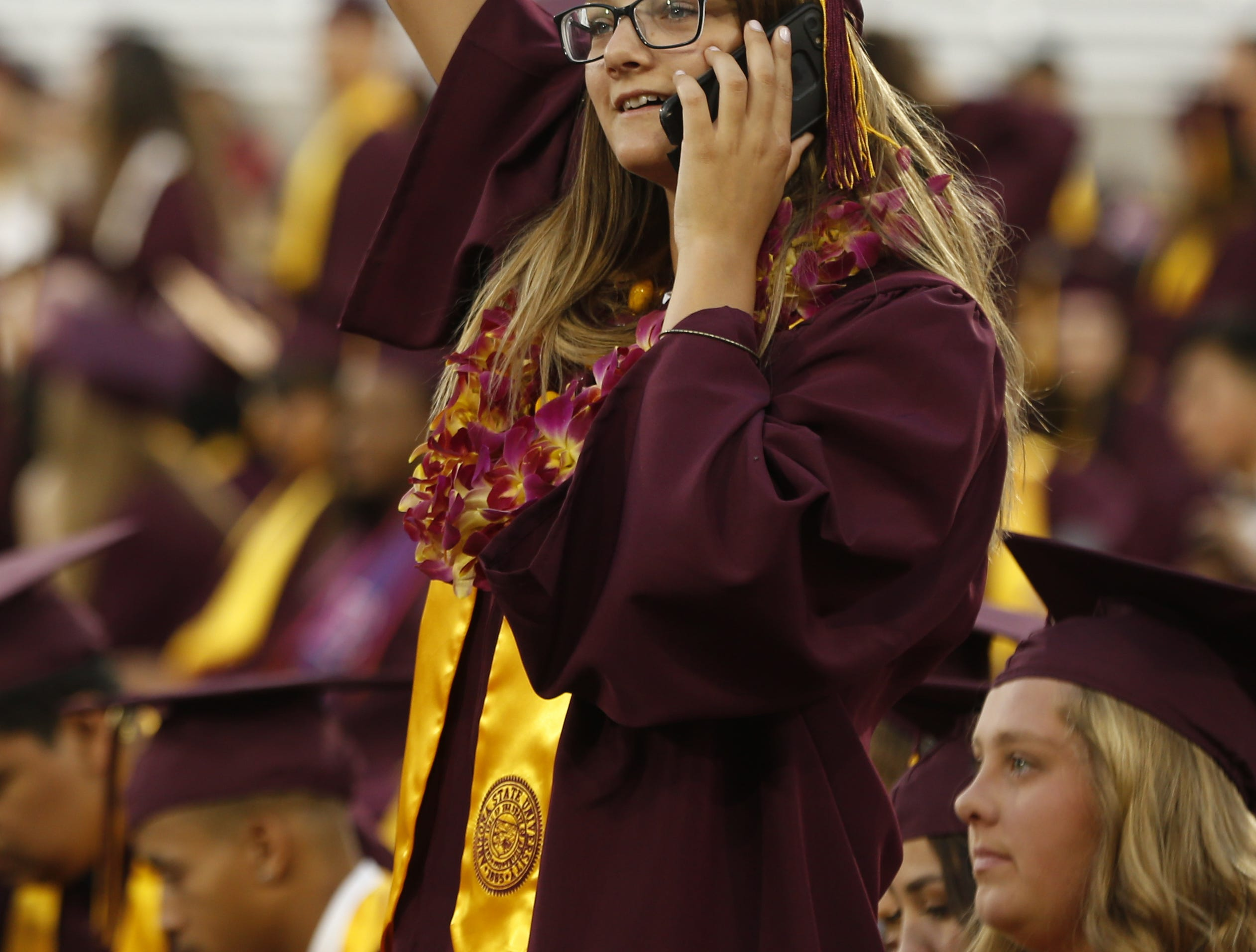 ASU graduates arrive and look for seats before ASU's Undergraduate Commencement at Sun Devil Stadium in Tempe, Ariz. on May 6, 2019.