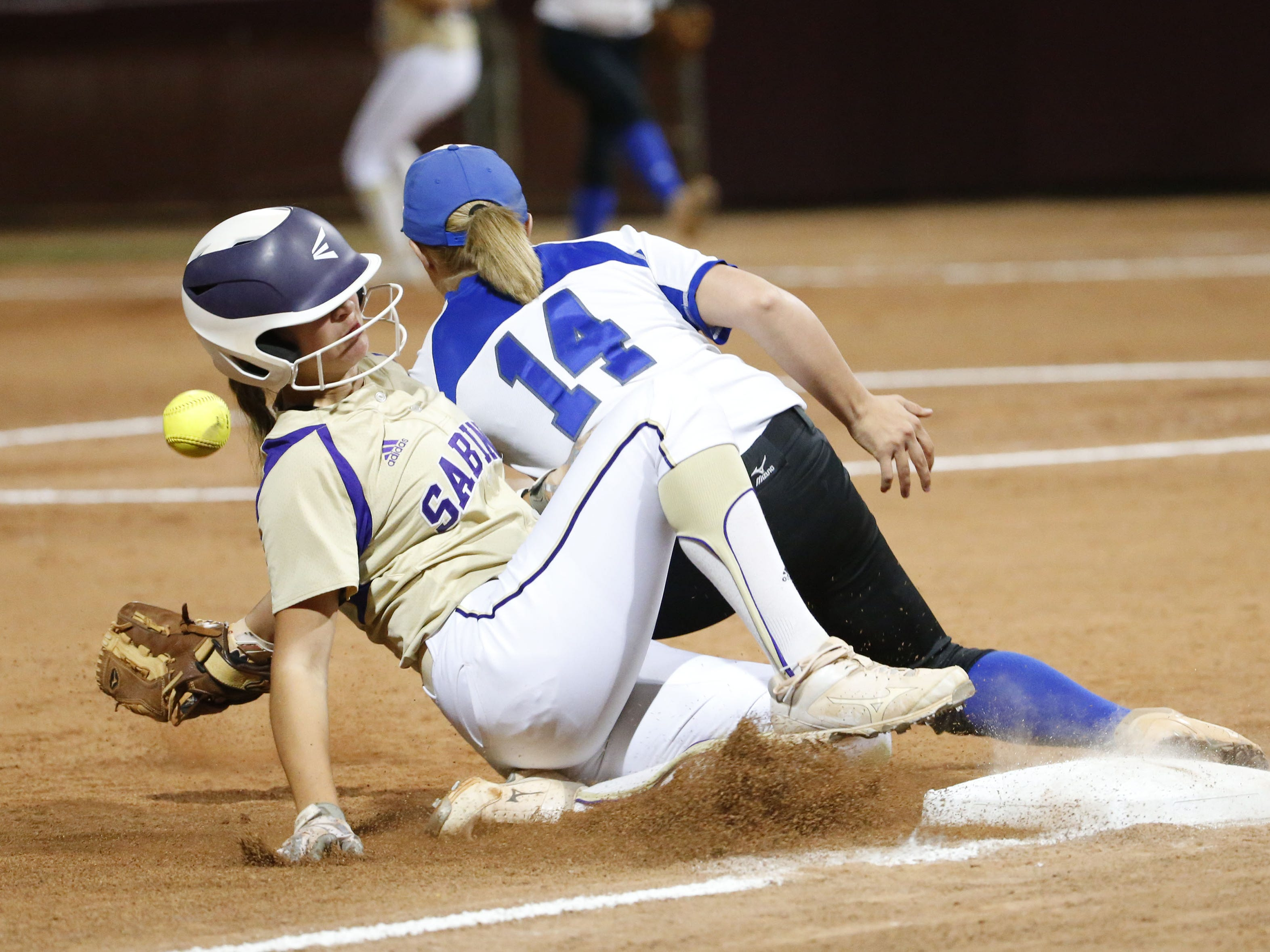 Sabino's Madison Filmore-Moreno (8) slides safely into third base ahead of the tag by Snowflake third baseman Hallie McCray (14) during the 3A softball state championship game in Tempe May 6, 2019.