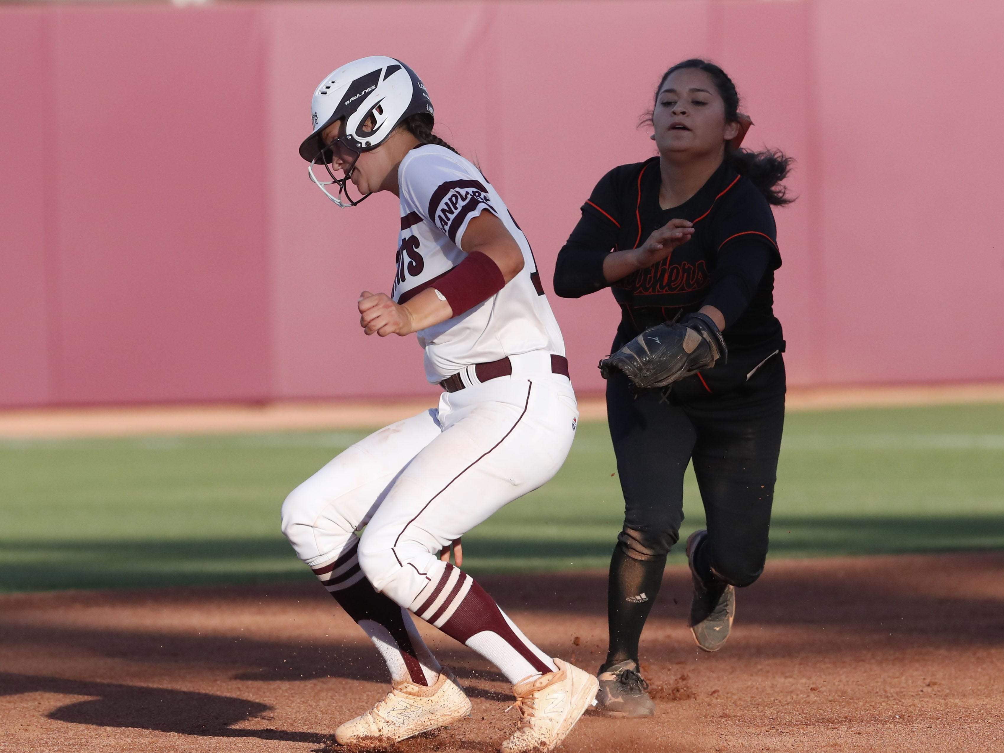 Ray catcher Tara Loroña (13) runs around the tag by Superior shortstop Anisah Cardenas (3) during the 1A softball state championship game in Tempe May 6, 2019.