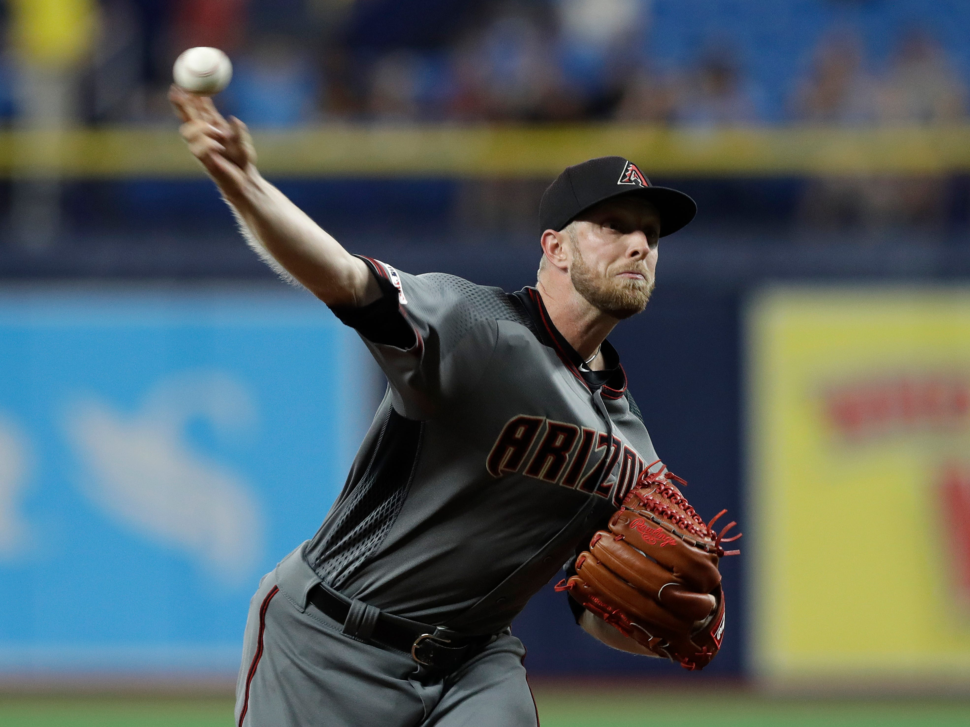 Arizona Diamondbacks starting pitcher Merrill Kelly delivers to the Tampa Bay Rays during the first inning of a baseball game Monday, May 6, 2019, in St. Petersburg, Fla. (AP Photo/Chris O'Meara)