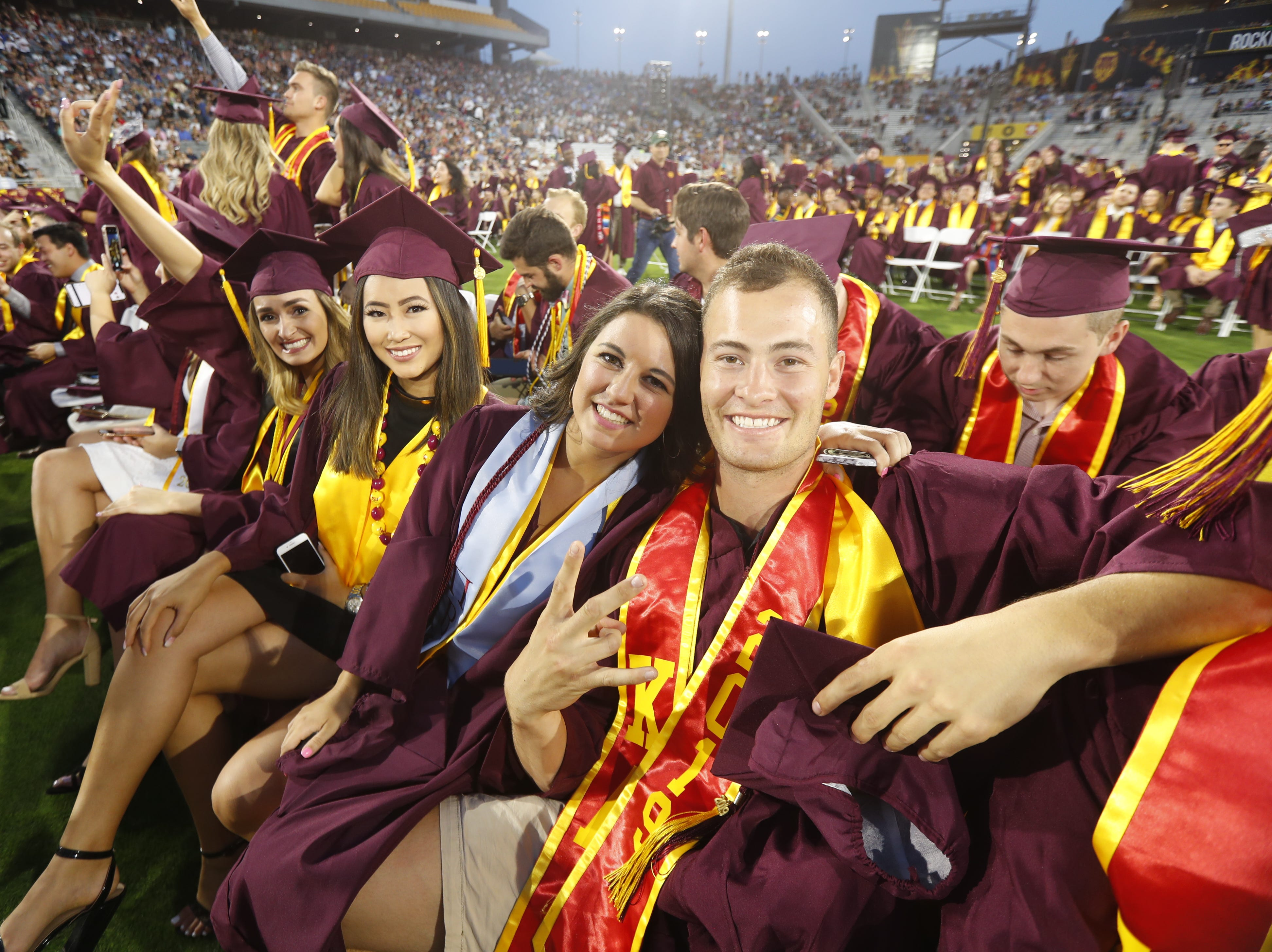 ASU graduates pose for picture during ASU's Undergraduate Commencement at Sun Devil Stadium in Tempe, Ariz. on May 6, 2019.