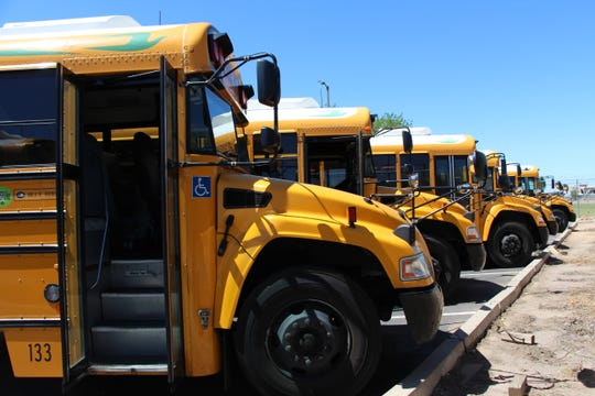 A line of school buses parked at the bus yard for Phoenix High School Union bus. On April 11, 2019, the district approved the purchase of an electric school bus, the first in a pilot program. Environmentalists call it a small, but significant first step toward cleaner air.
