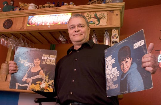 Disc jockey Paco Cruz holds two of his many Eydie Gormé records in his music room at his home in Phoenix in 2006.