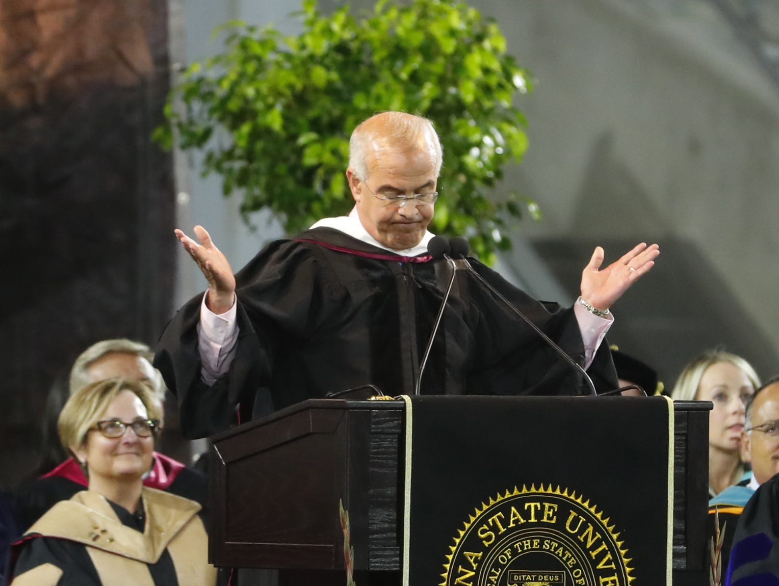 David Brooks speaks after receiving his honorary degree during ASU's Undergraduate Commencement at Sun Devil Stadium in Tempe, Ariz. on May 6, 2019.