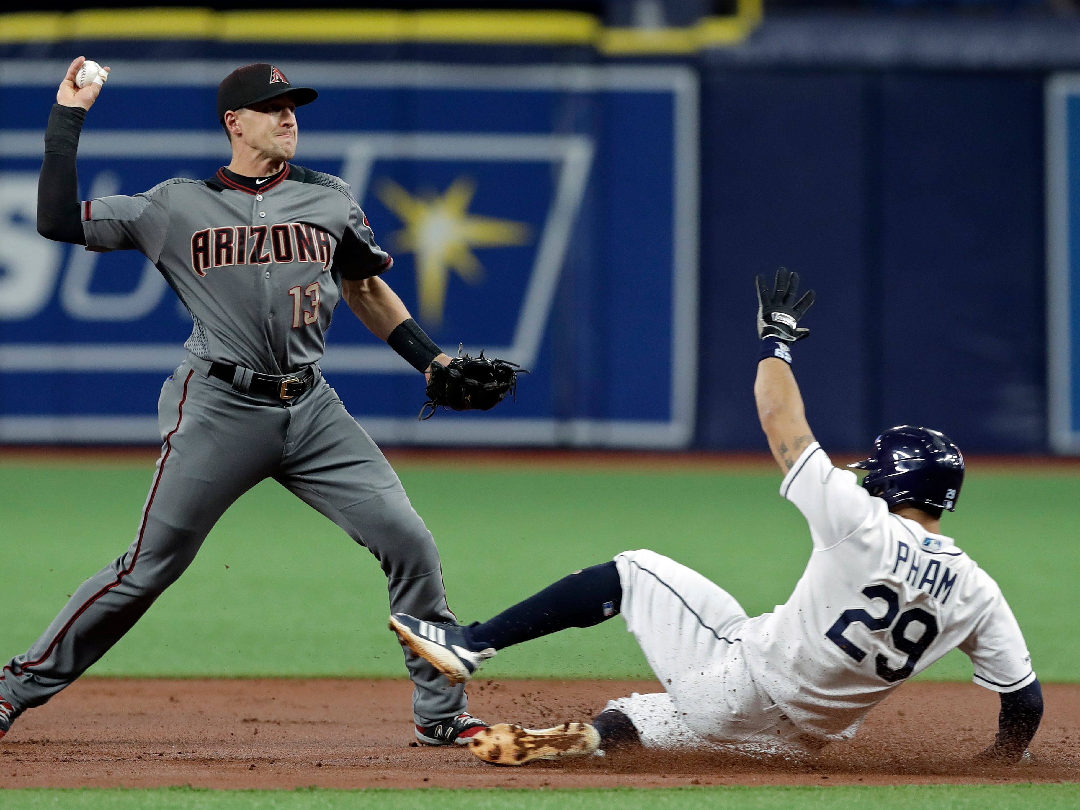 Arizona Diamondbacks shortstop Nick Ahmed (13) forces out Tampa Bay Rays' Tommy Pham at second on a fielder's choice by Ji-Man Choi during the first inning of a baseball game Monday, May 6, 2019, in St. Petersburg, Fla.