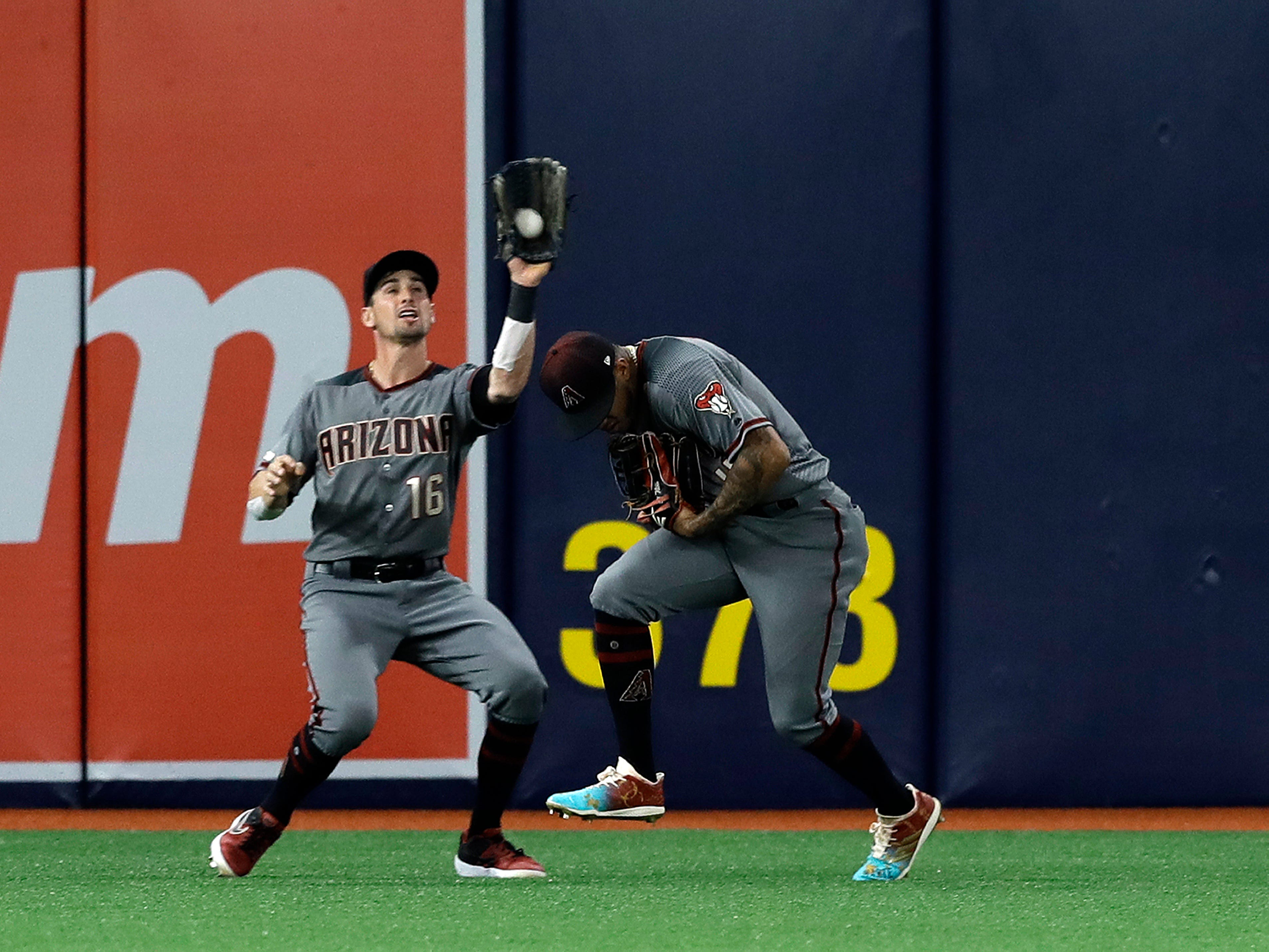 Arizona Diamondbacks left fielder Tim Locastro (16) avoids colliding with center fielder Ketel Marte after catching a fly-out by Tampa Bay Rays' Kevin Kiermaier during the third inning of a baseball game Monday, May 6, 2019, in St. Petersburg, Fla. (AP Photo/Chris O'Meara)