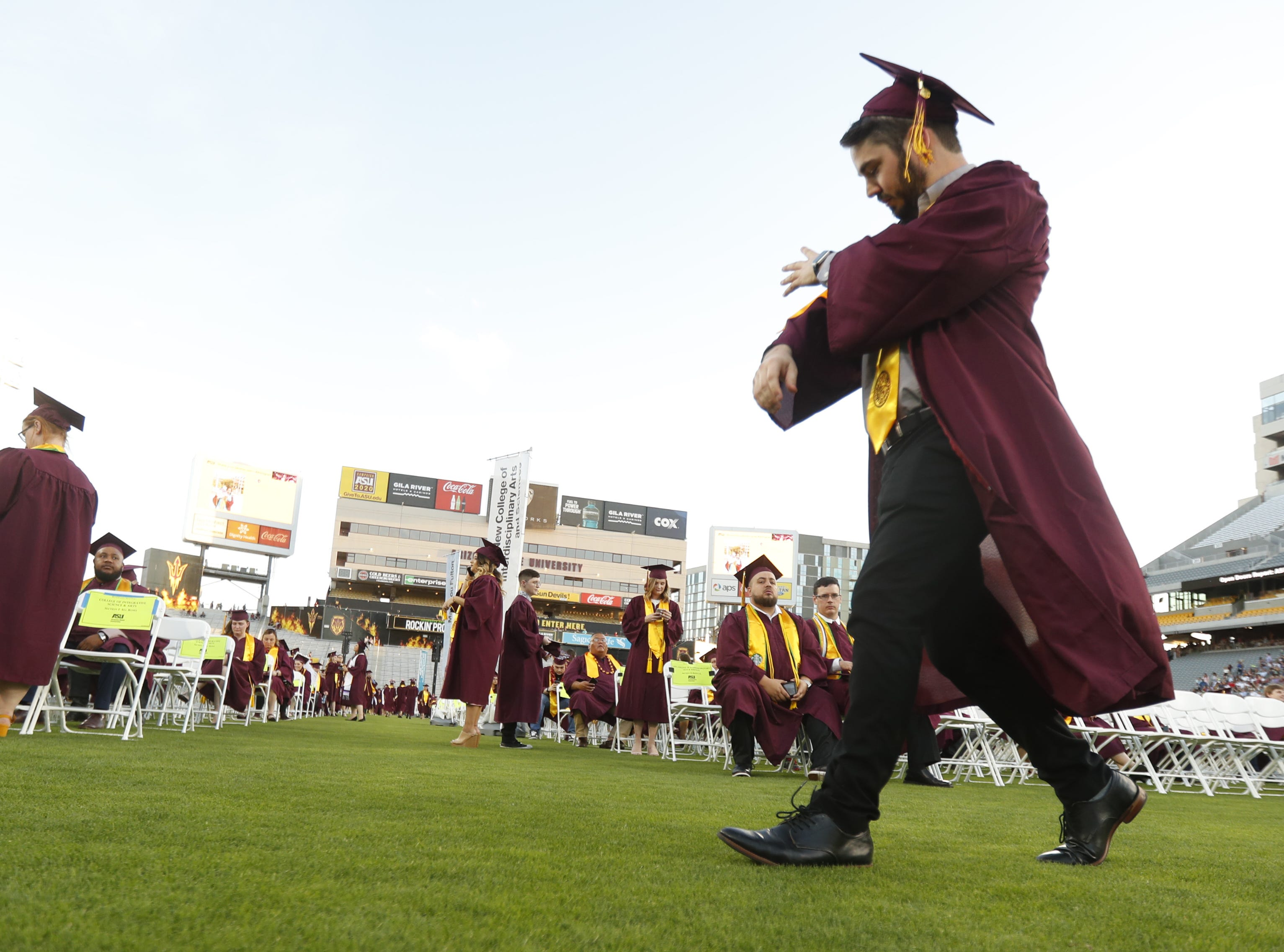 ASU soon-to-be grads arrive during ASU's Undergraduate Commencement at Sun Devil Stadium in Tempe, Ariz. on May 6, 2019.