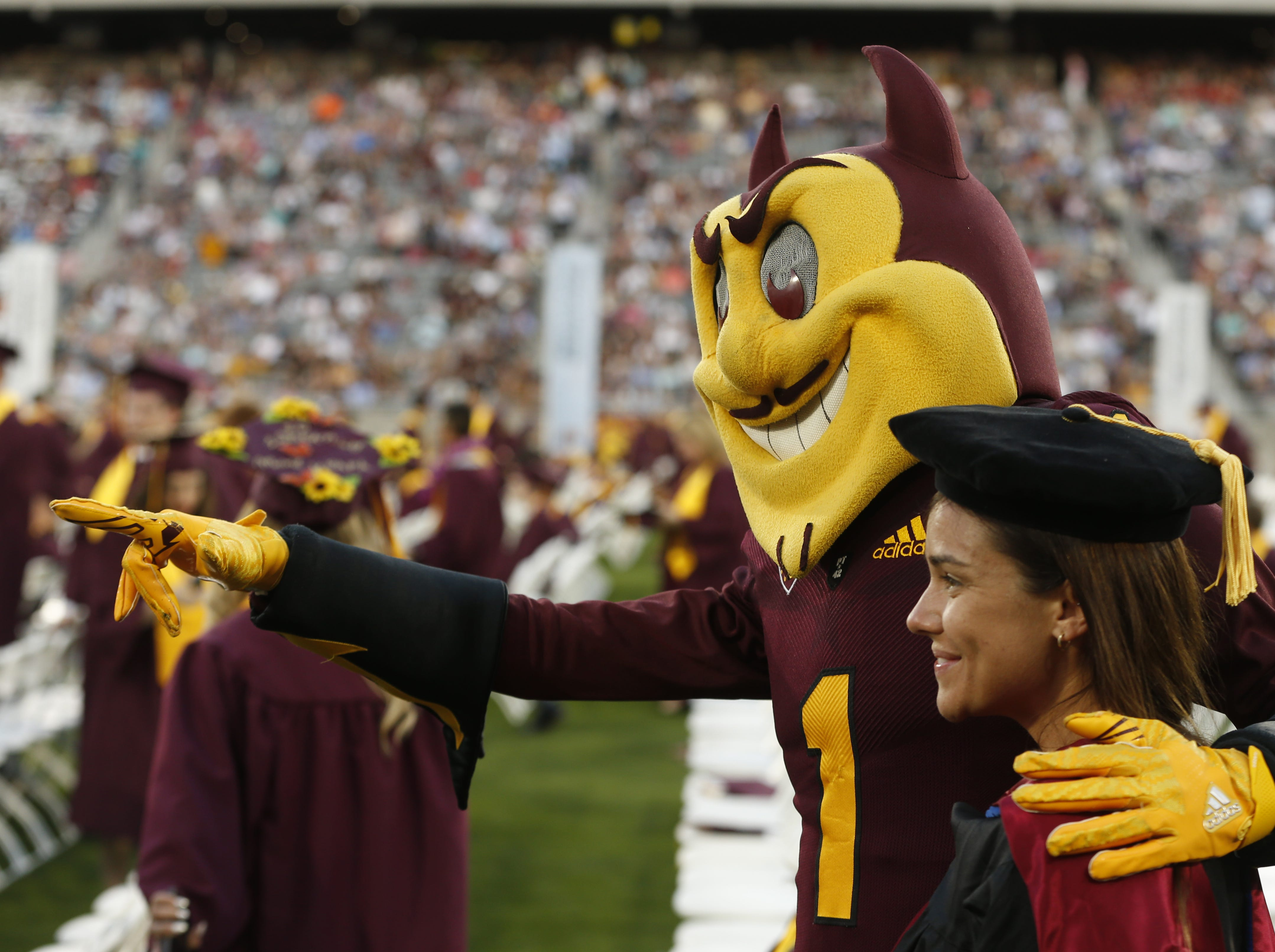 Sparky poses for pictures during ASU's Undergraduate Commencement at Sun Devil Stadium in Tempe, Ariz. on May 6, 2019.