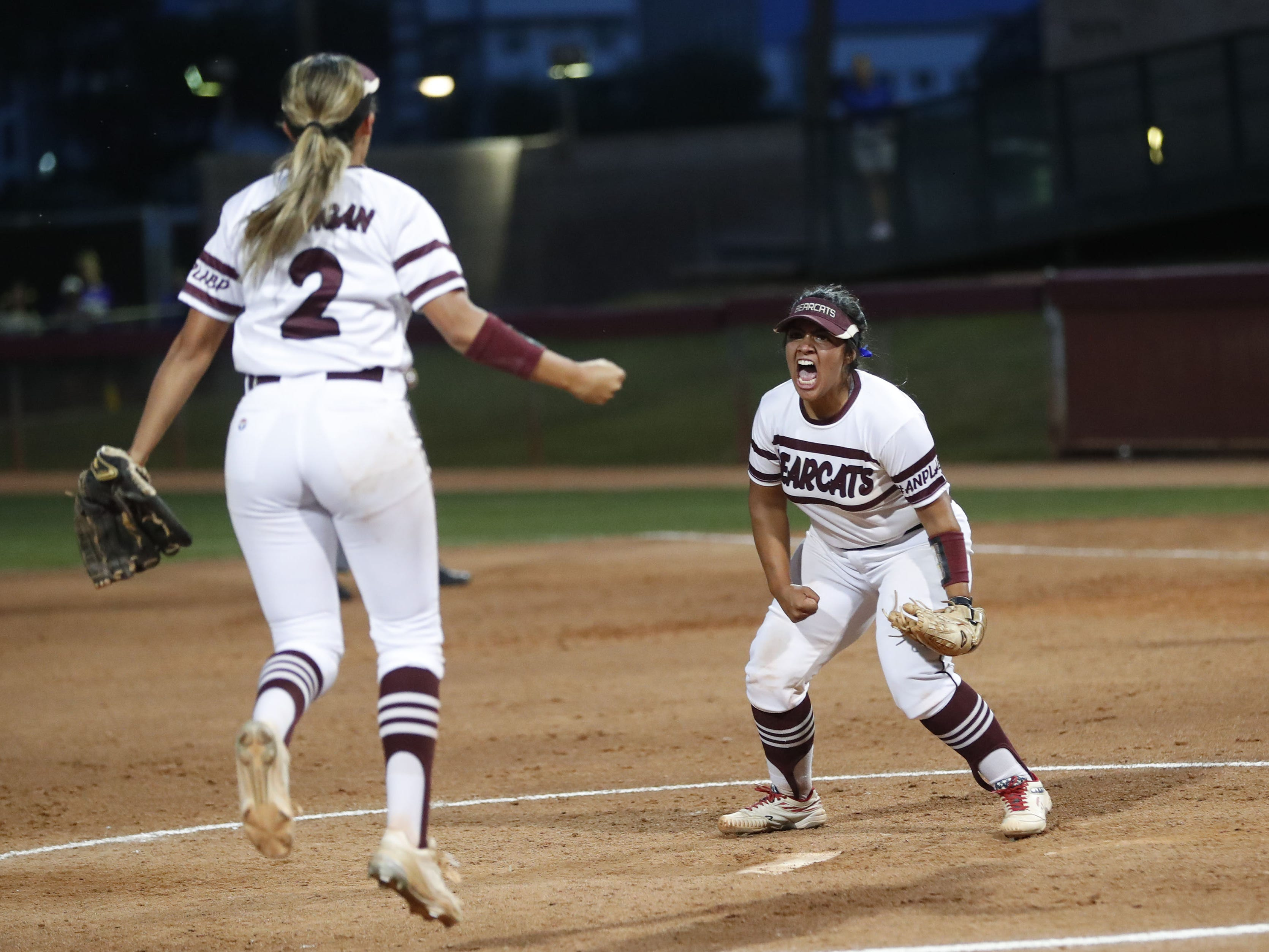 Ray pitcher Daniella Hinojos (21) and third baseman Marissa Barragan (2) celebrate after beating Superior in the 1A softball state championship game in Tempe May 6, 2019.