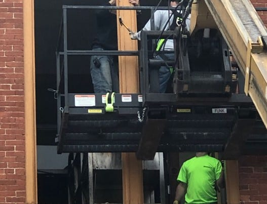 Scenes from a crew removing a 2,000-pound wood fire grill through a third-story window at the Lebanon Farmers Market. The grill belongs to Foundry Craft Grillery, which closed April 27.