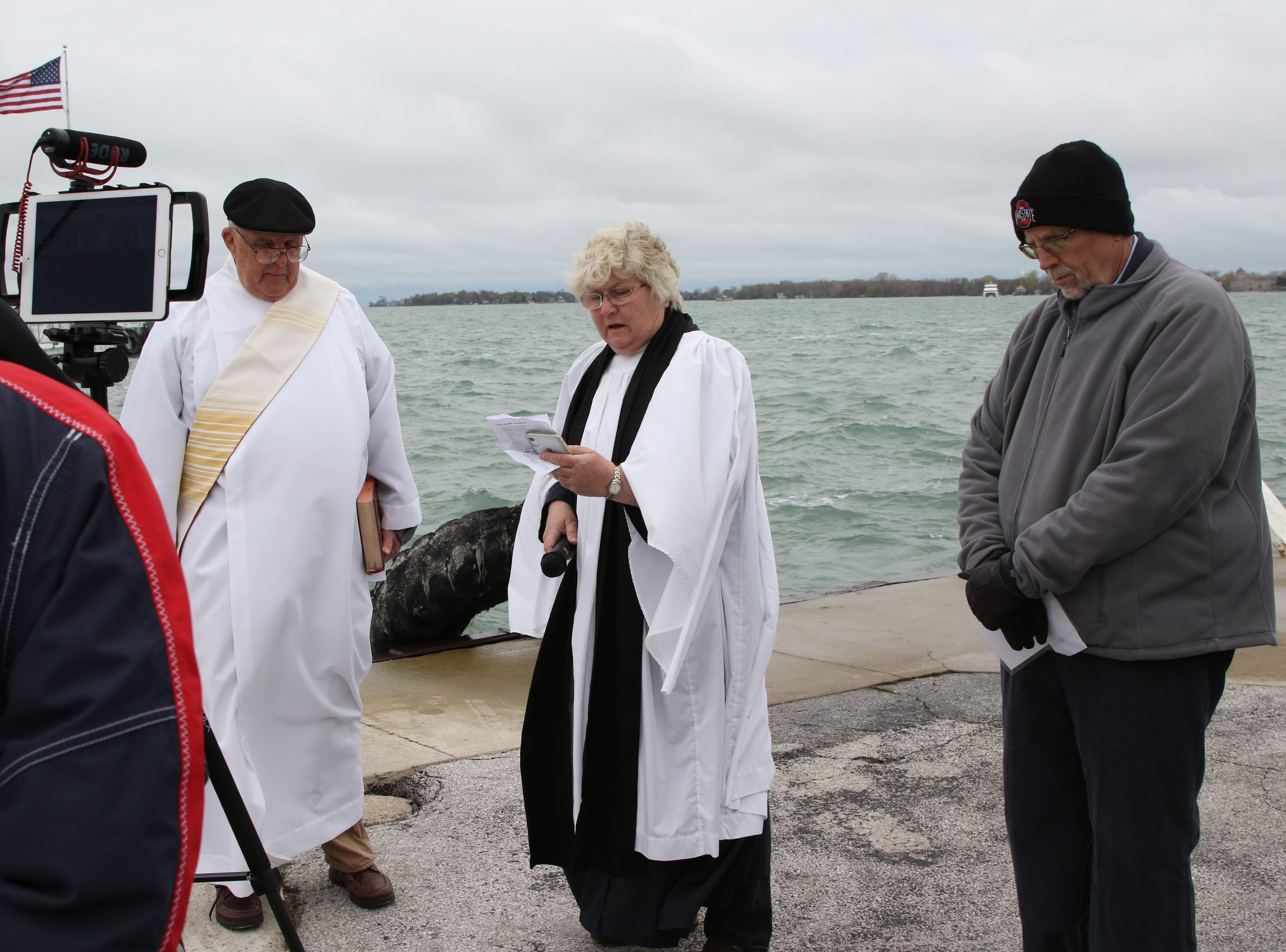 Members of the clergy from South Bass Island churches say prayers to bless the fleet Tuesday at Fox's Dock in Put-in-Bay Harbor. From left are Deacon Mike Leahy of Mother of Sorrows Catholic Church, the Rev. Mary Staley of St. Paul Episcopal Church, and the Rev. Jim Lehman of St. John Lutheran Church.