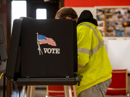 A man fills out his ballot in Marine City's Precinct 1 polling place at the Marine City Fire Hall during Tuesday's special election. Three school districts have proposals on the ballot.