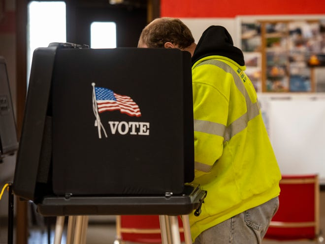 A man fills out his ballot in Marine City's Precinct 1 polling place at the Marine City Fire Hall during an election in May this year.