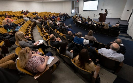 Michigan Attorney General Dana Nessel speaks in front of a crowd in an auditorium at SC4 Tuesday, May 7, 2019, during a FOIA and OMA seminar.