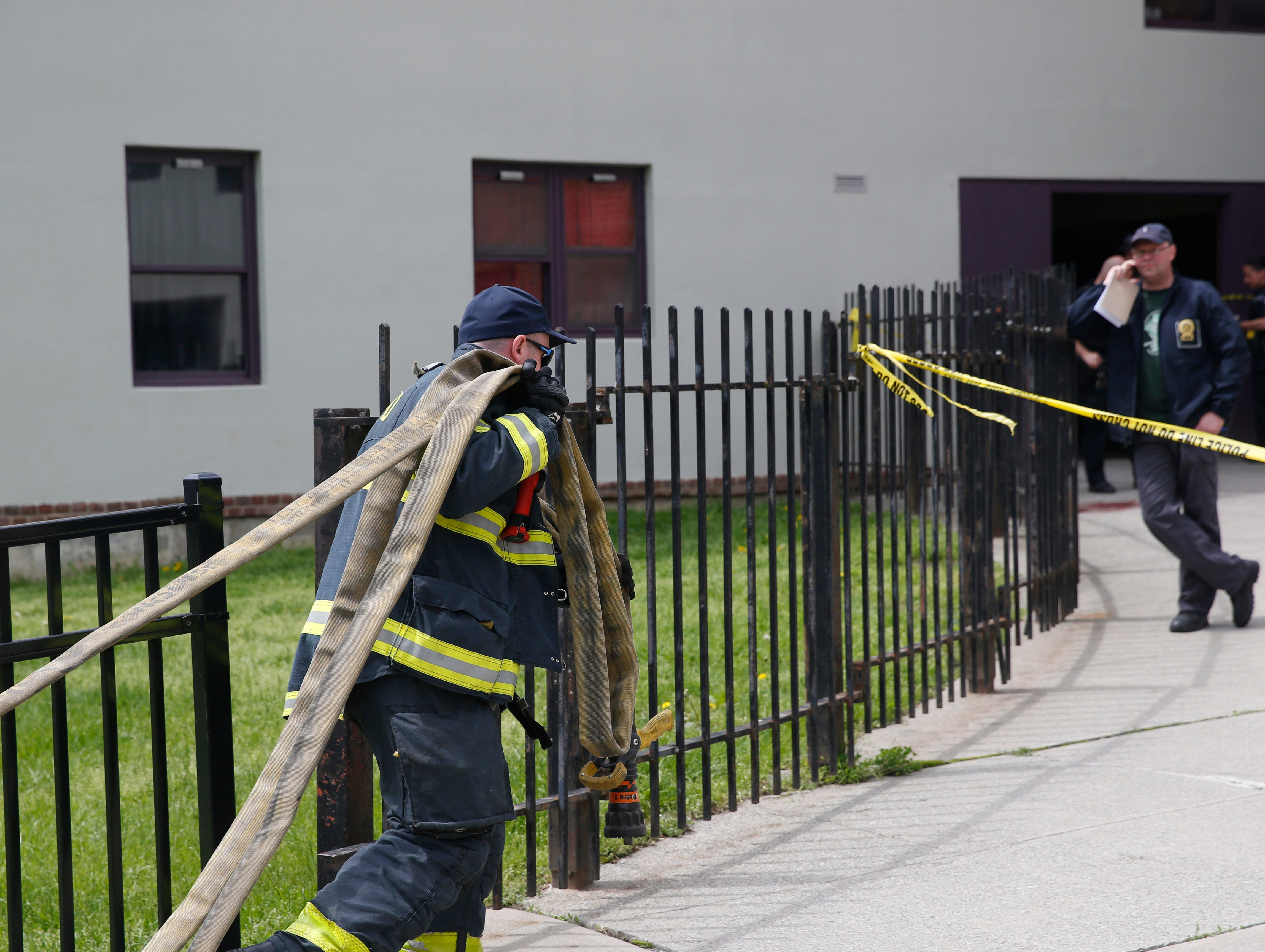 City of Poughkeepsie Fire Department arrives to clean blood spilled from a shooting that occurred at the Hudson Gardens Apartments in the City of Poughkeepsie on May 7, 2019.