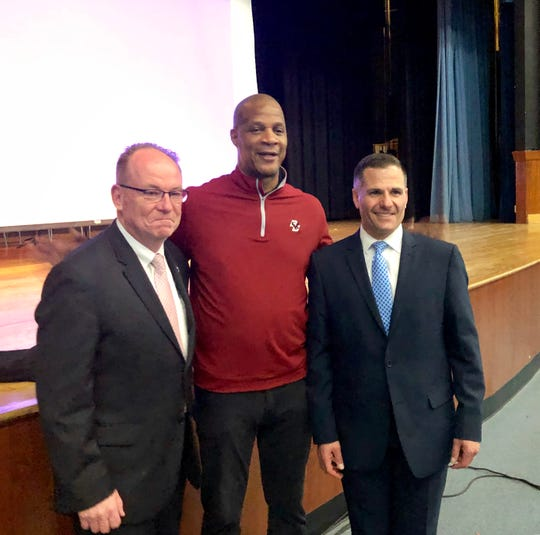 Darryl Strawberry poses alongside Poughkeepsie mayor Rob Rolison and Dutchess County Executive Marc Molinaro at Poughkeepsie High School on Tuesday.