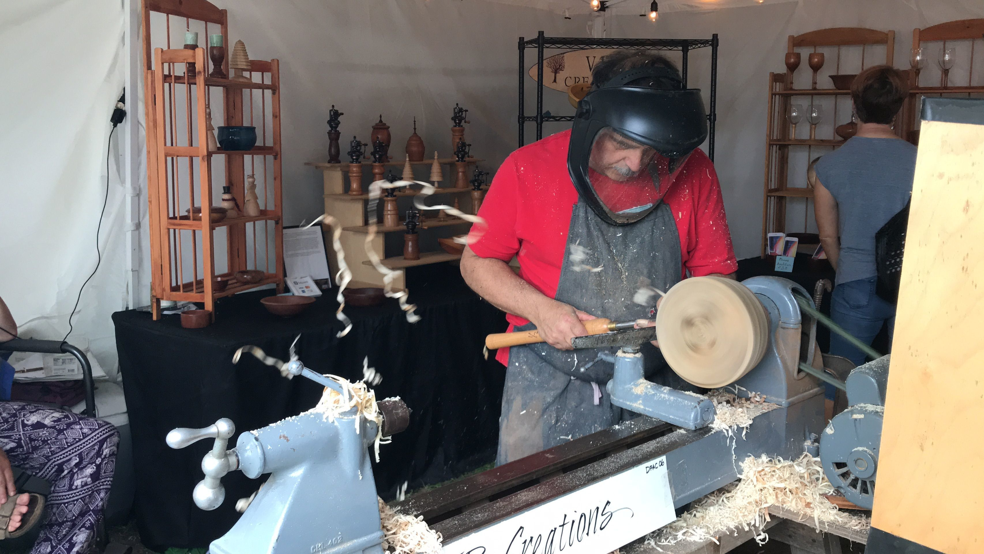 Joe Botta, of VJB Creations, works on a wooden bowl at the Woodstock-New Paltz Art & Crafts Fair in New Paltz on Sept. 2, 2018. This year's event is set for May 25-27.
