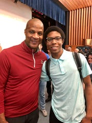 Darryl Strawberry poses for a photo with Poughkeepsie High School senior Brandon Grant.