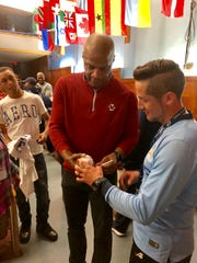 Darryl Strawberry autographs a ball for Poughkeepsie High School soccer coach Daniel Gil.