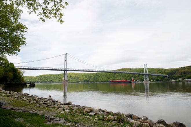 A tank barge passes under the Mid-Hudson Bridge in the City of Poughkeepsie on May 6, 2019.