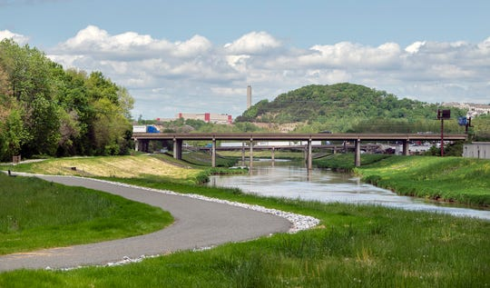 Looking north on the recently opened stretch of the Northern Extension of the Heritage Rail Trail County Park with the Interstate 83 bridge in the background, with the Route 30 bridge behind it.