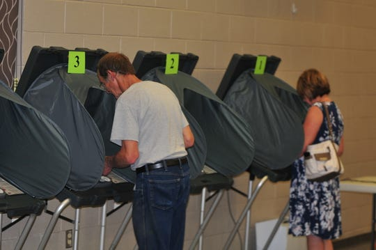 Ron Smith and Karen Johnson vote Tuesday at First English Lutheran Church.