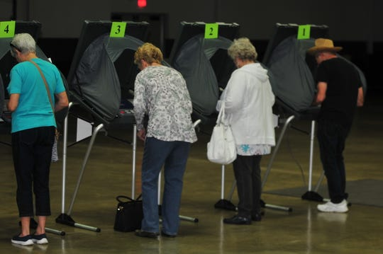Voters cast ballots inside the Kuhlman Center on the Wayne County Fairgrounds during the primary election on Tuesday, May 7, 2019.