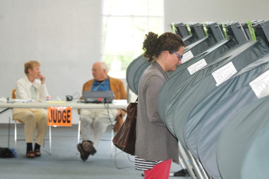 Marcie Roberts votes Tuesday inside First Baptist Church.