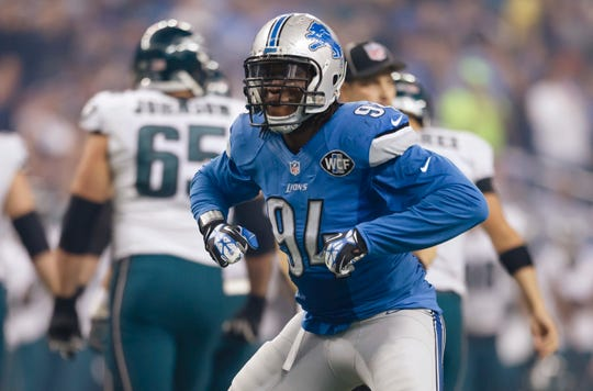 """FILE - In this Nov. 26, 2015, file photo, Detroit Lions defensive end Ezekiel """"ZIggy"""" Ansah (94) celebrates after a play during an NFL football game against the Philadelphia Eagles in Detroit."""