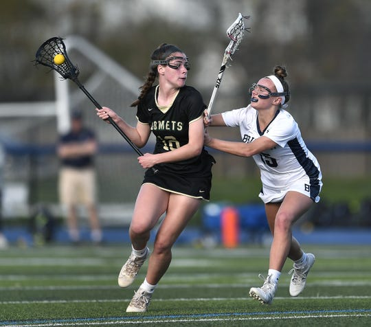 Rush-Henrietta's Rachel Crane, left, is defended by Brighton's Susan Lafountain during a game at Brighton High School, Monday, May 6, 2019. Rush-Henrietta beat Brighton 9-3.
