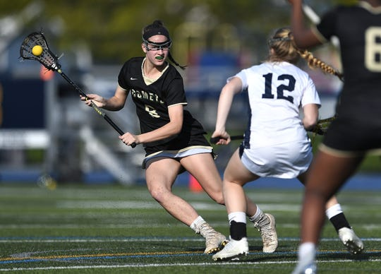 Rush-Henrietta's Courtney Rowe, left, is defended by Brighton's Megan Marangola during a game at Brighton High School, Monday, May 6, 2019. Rush-Henrietta beat Brighton 9-3.