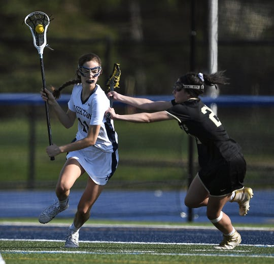 Brighton's Emma Little, left, is defended by Rush-Henrietta's Jenna DeVito during a game at Brighton High School, Monday, May 6, 2019. Rush-Henrietta beat Brighton 9-3.