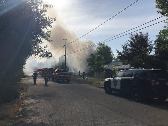 Smoke is heavy Tuesday, May 7, 2019 in southeast Redding because of house fire in the 2300 block of Alden Avenue.